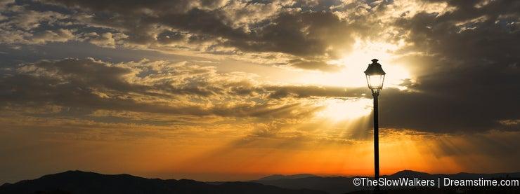Sunbeams, viewed through a solitary lamp post, Sedella, Spain.