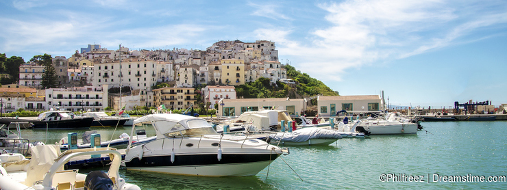 boats harbor typical Italian seaside village Rodi Garganico Gargano Apulia Italy colorful