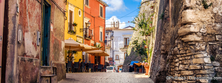 Colorful south italy village alley in Apulia in the town of Vico del Gargano, Italy