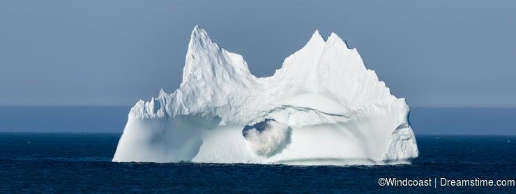 Iceberg with a Wave Crashing Through Large Hole, Newfoundland