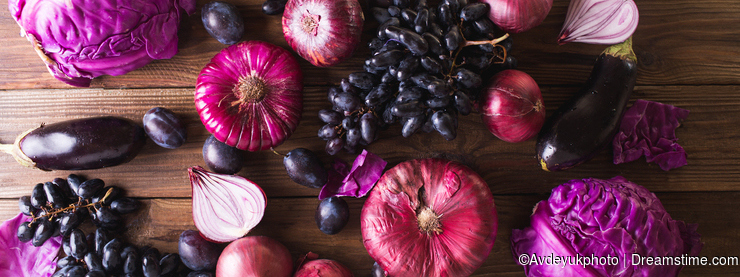 Purple fruits and vegetables. Blue onion, purple cabbage, eggplant, grapes and plums