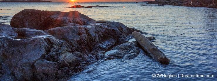 Sunrise in hidden cove at Cattle Point in British Columbia