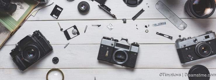 Broken film camera component repair and maintenance of photographic equipment concept