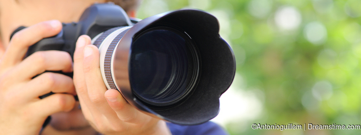 Close up of a photographer using a dslr camera