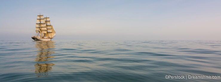 Brig drifting at dead calm sea