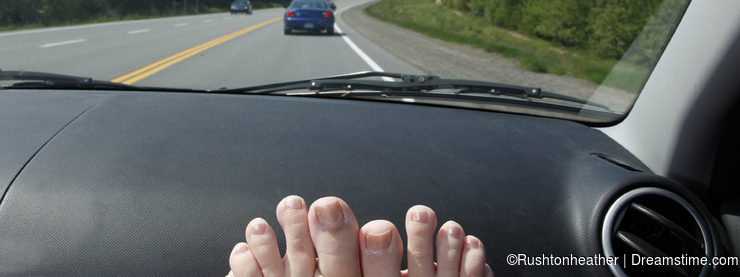 Feet on dashboard on vacation or road trip