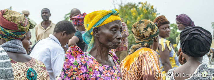 African woman on crowded market, Uganda