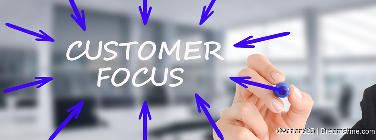 Customer focus concept with businesswoman writing with marker on transparent background