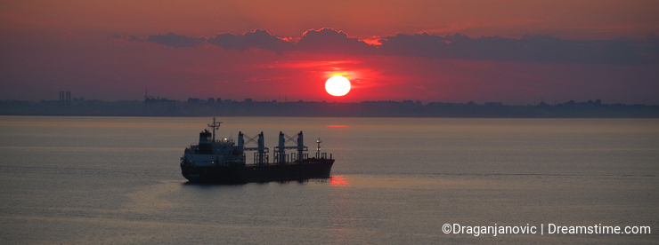 Cargo vessel at sunset