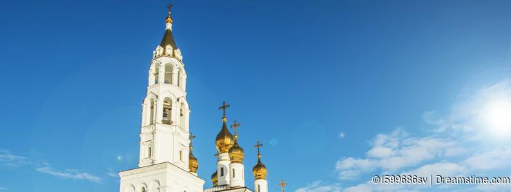 Orthodox Church against the blue sky and construction