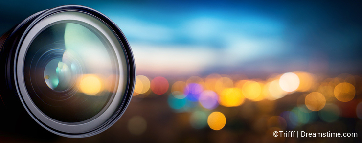 Camera lens with lens reflections. Media and technology concept background.