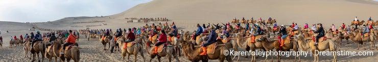 Panorama of crowds at camel rides, Singing Sand Mountain, Taklamakan Desert, Dunhuang, China