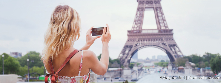 Tourist taking photo of Eiffel tower in Paris