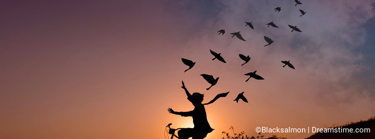 Freedom concept, Silhouette of happy person raised arms on bicycle in natural scene, Birds fly on beautiful sunrise or sunset sky