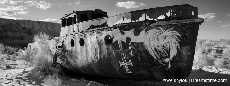 Abandoned ship in the Aral Sea with graffiti