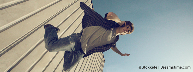 Young man is falling from a building