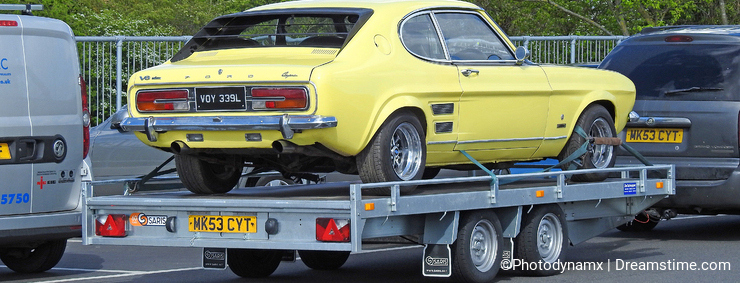Vintage classic ford capri car on transporter vehicle lorry towed tow