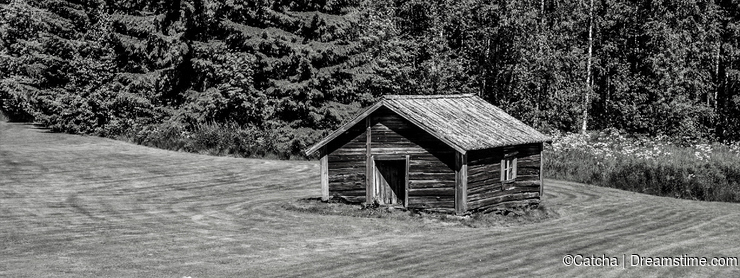 Historic wooden shed in Finland black and white