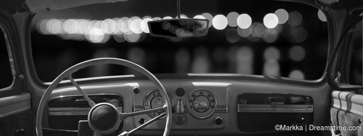 Old cabin, console and steering wheel in a vintage retro car. Ni