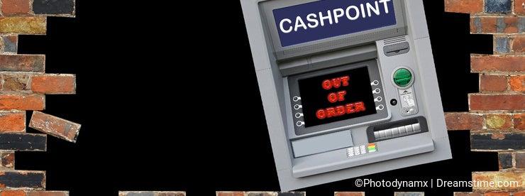 Cashpoint crash hole in the wall vandalism cash money machine atm thief theft town city