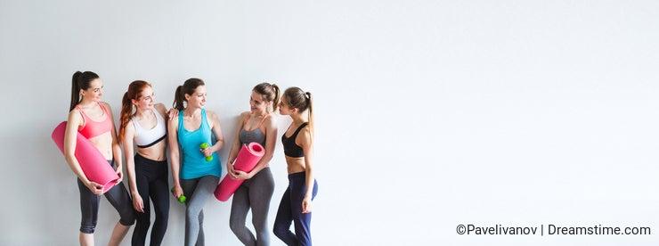 Smiling women yoga / fitness class.