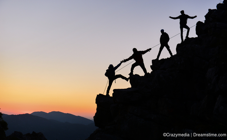 Climbers working together