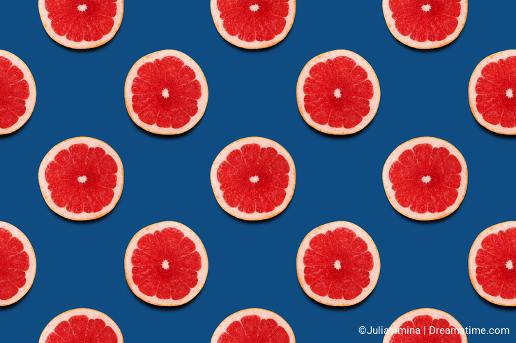 Grapefruit slices seamless pattern on classic blue background summer year 2020 juicy color.