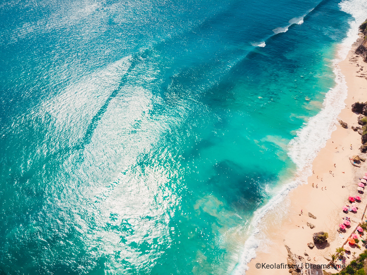 Aerial view, drone shot. Beautiful sandy beach with turquoise ocean in Bali.