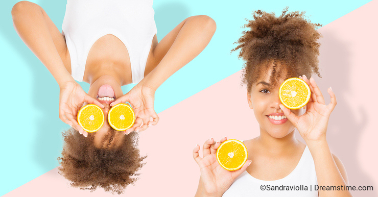 Summer time holidays. Beautiful young african american women with orange fruit food collage isolated . Afro girl and diet concept