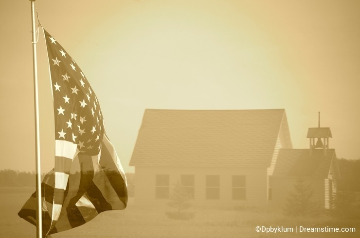 An American Flag is imposed on an Old Schoolhouse