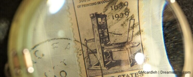Close up of machine cancelled postage stamp through marine magnifying glass