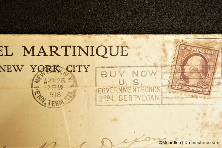Antique mail with cancelled Washington stamp on spotted New York City envelope