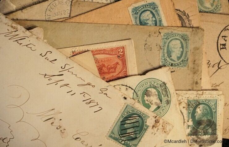 Antique mail with hand cancelled stamps and cachet on yellowed envelopes