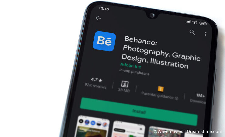 Adobe Behance app play store page on the display of a black mobile smartphone isolated on white background