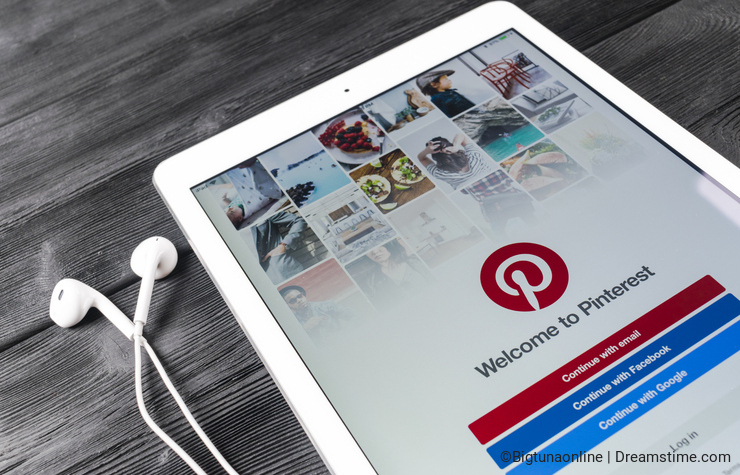 Apple iPad Pro with social Internet service Pinterest on the screen. Pinterest application on tablet computer screen.