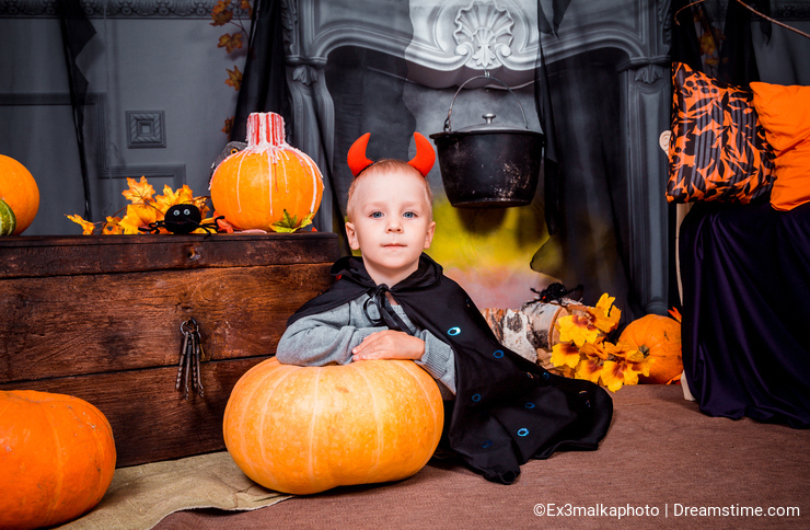 Little boy on Halloween looks at the camera