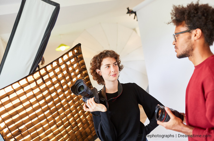 Two photographers discuss a photo shoot