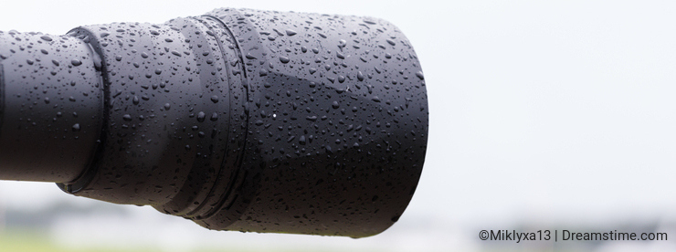 Lens hood in the rain, raindrops on black plastic