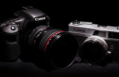 New and old photography equipment for a photographer