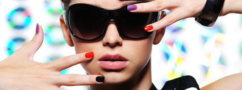 Stock photo: woman with fashion manicure and stylish sunglasses