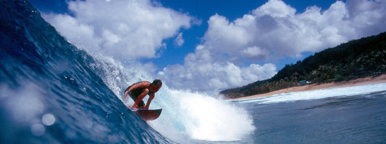 Stock photo: surfer surfing on the north shore in blue hawaii