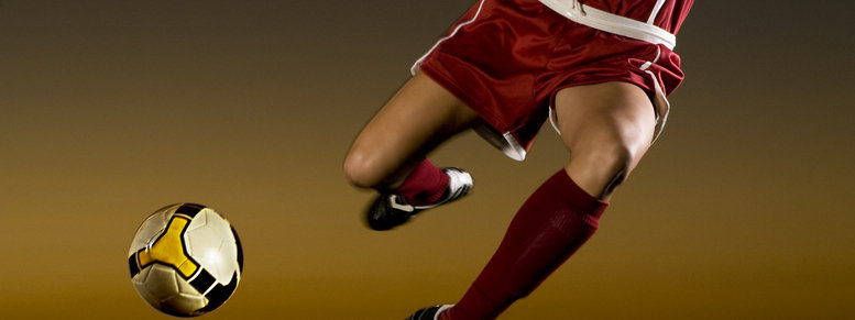Stock photo: female soccer player about to kick the ball
