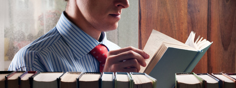 Stock photo: men reading a book