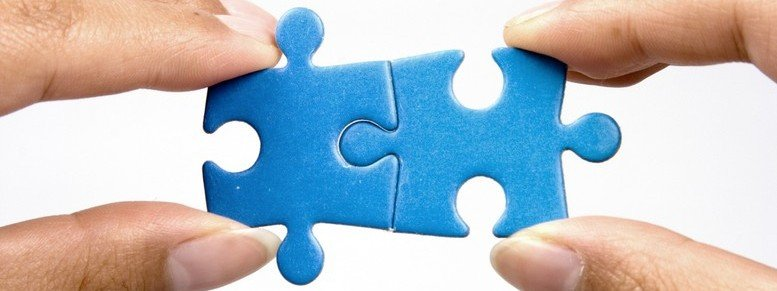 Stock photo: holding jigsaw puzzle