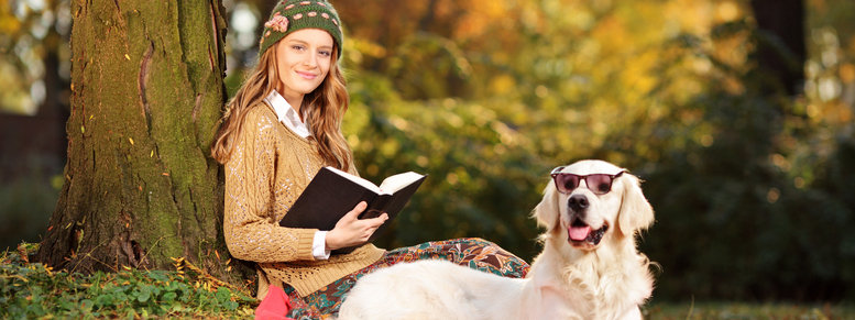 Stock photo: smiling young woman relaxing with her dog