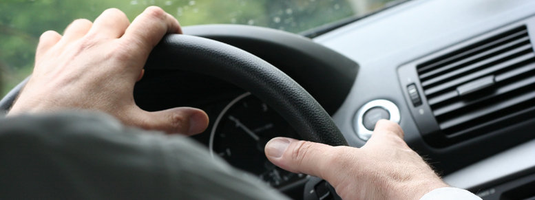 Stock photo: driving a car / steering wheel