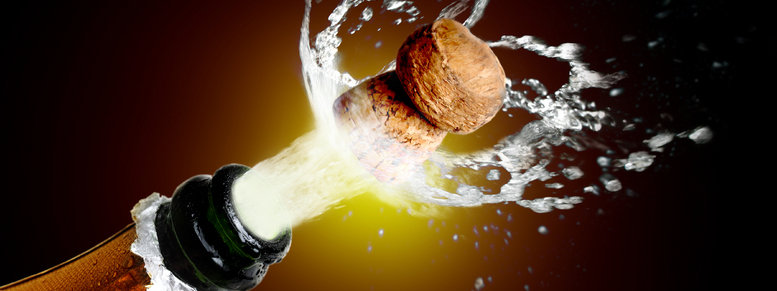 Stock photo: close up of champagne cork popping