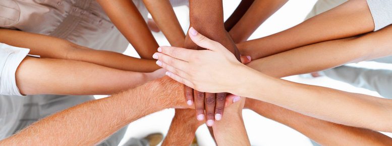 Stock photo: business people-hands overlapping to show teamwork
