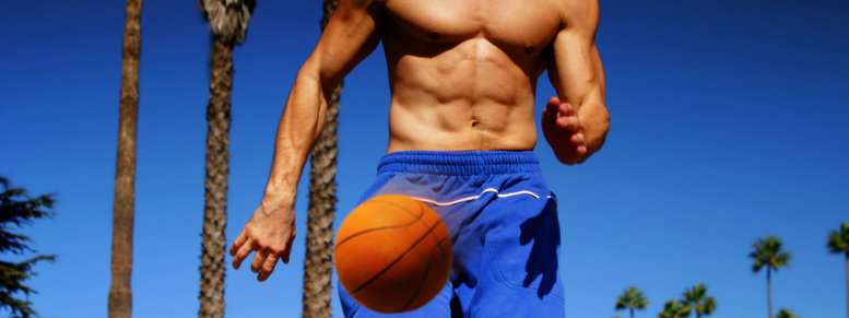 Stock photo: athlete dribbling basketball