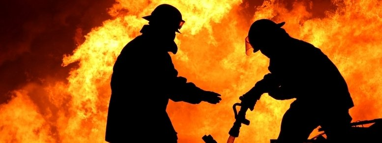 Stock photo: brave firefighters in silhouette